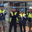 Kristina Wischnowsky, centre, with workers on site.